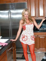 Kelly the domestic diva satisfies her self on the kitchen counter in red thigh highs.