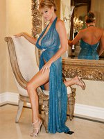 Kelly is wearing a blue see thru gown and showing off her body in the mirror.