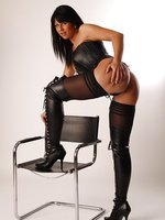 Desyra Noir in Stockings and Black Leather Boots