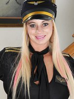 Busty mature flight attendant Crystal Forrester strips naked.
