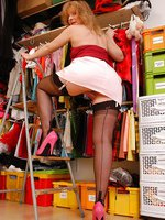 Angel in dark brown ff stockings on a ladder