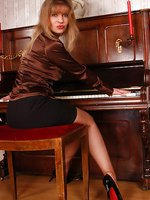 Angel the piano girl in sheer brown stockings