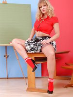 Angel as naughty Teacher in tender brown stockings