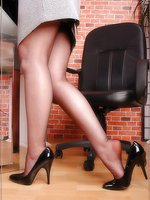 Blonde secretary in black bareffet stockings
