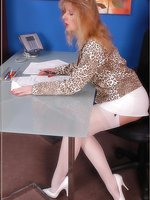 Secretary in white stockings gives her co-worker a lustful job
