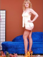 Hot blonde in genuine stockings with seams