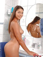 Super sexy babe in a bathroom scene