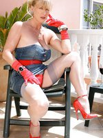Astrid relaxes on the terrace in grey FFS nylons and red heels