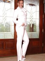 Beauty in nylon pantyhose and white suit