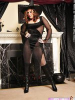 Brunette witch in high heels and nylon